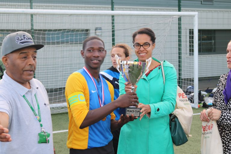 The Peace Cup 2016-Cllr Kaya Comer-Schwartz presenting the Peace Cup to the winning team, MWH
